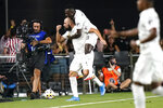 Inter Miami's Gonzalo Higuain, left, celebrates with midfielder Blaise Matuidi (8) after scoring a goal against the Columbus Crew during the first half of an MLS soccer match Saturday, Sept. 11, 2021, in Fort Lauderdale, Fla. (AP Photo/Lynne Sladky)