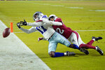 Dallas Cowboys wide receiver Malik Turner (17) can't hold on to the ball as Arizona Cardinals safety Deionte Thompson (22) defends during the second half of an NFL preseason football game, Friday, Aug. 13, 2021, in Glendale, Ariz. (AP Photo/Ross D. Franklin)