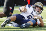 Navy wide receiver Zach Abey reacts after being sacked by Cincinnati defensive tackle Cortez Broughton in the first half of an NCAA college football game, Saturday, Nov. 3, 2018, in Cincinnati. (AP Photo/John Minchillo)