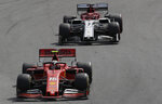 Ferrari driver Charles Leclerc, of Monaco, steers his car followed by Alfa Romeo driver Kimi Raikkonen, of Finland, during the Brazilian Formula One Grand Prix at the Interlagos race track in Sao Paulo, Brazil, Sunday, Nov. 17, 2019. (AP Photo/Silvia Izquierdo)