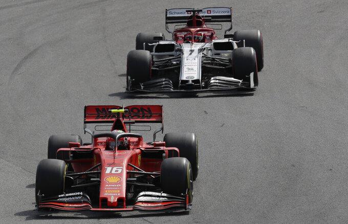Ferrari driver Charles Leclerc, of Monaco, steers his car followed by Alfa Romeo driver Kimi Raikkonen, of Finland, during the Brazilian Formula One Grand Prix at the Interlagos race track in Sao Paulo, Brazil, Sunday, Nov. 17, 2019. (AP Photo/Silvia Izquierdo)