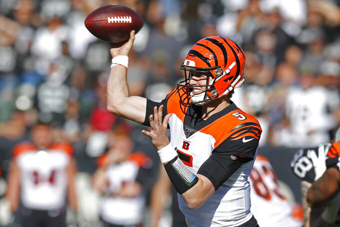 Cincinnati Bengals quarterback Ryan Finley throws the ball during the first half of an NFL football game against the Oakland Raiders in Oakland, Calif., Sunday, Nov. 17, 2019. (AP Photo/D. Ross Cameron)