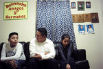 "In this Nov. 21, 2019, photo Audencio Lopez, center, who crossed the border illegally as a teenager in 1997, is seated with two of his children, Anaias, 12, left, and Mercy, 8, right, during an interview with The Associated Press, at their home in Lynn, Mass. After going through the immigration court process for seven years, Lopez was told at a court hearing this past fall that the government won't oppose granting him a visa due to his ""exemplary"" record and community service. But Lopez admits the family's joy is tempered by uncertainty because his wife's immigration status remains unresolved. (AP Photo/Steven Senne)"