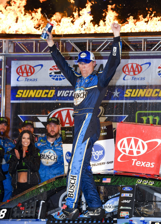 Kevin Harvick celebrates in Victory Lane after winning a NASCAR Cup Series auto race at Texas Motor Speedway, Sunday, Nov. 3, 2019, in Fort Worth, Texas. (AP Photo/Larry Papke)