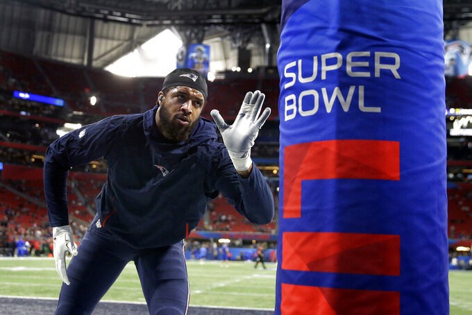 New England Patriots' Deatrich Wise Jr. warms up before the NFL Super Bowl 53 football game between the Patriots and the Los Angeles Rams, Sunday, Feb. 3, 2019, in Atlanta. (AP Photo/John Bazemore)