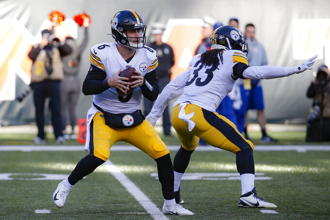 Pittsburgh Steelers quarterback Devlin Hodges (6) looks to pass during the second half an NFL football game against the Cincinnati Bengals, Sunday, Nov. 24, 2019, in Cincinnati. (AP Photo/Frank Victores)