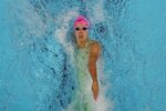 Regan Smith participates in the women's 100 backstroke during wave 2 of the U.S. Olympic Swim Trials on Tuesday, June 15, 2021, in Omaha, Neb. (AP Photo/Jeff Roberson)