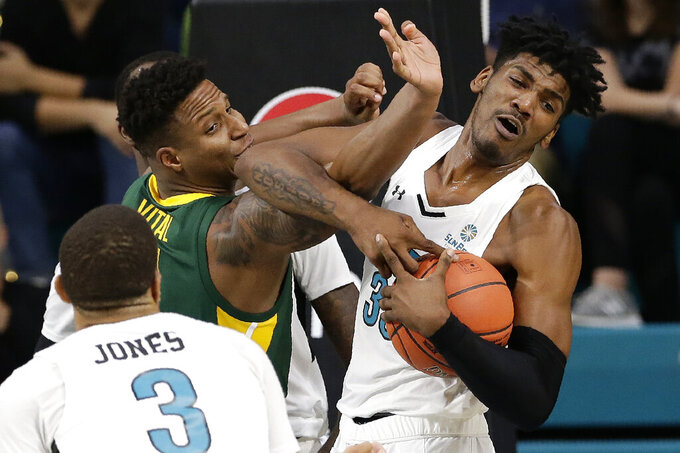 Baylor guard Mark Vital (11) and Coastal Carolina forward Tommy Burton (33) struggle for a rebound during the first half of an NCAA college basketball game at the Myrtle Beach Invitational in Conway, S.C., Friday, Nov. 22, 2019. (AP Photo/Gerry Broome)