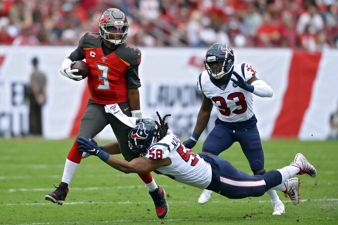 Tampa Bay Buccaneers quarterback Jameis Winston (3) is sacked by Houston Texans linebacker Peter Kalambayi (58) during the first half of an NFL football game Saturday, Dec. 21, 2019, in Tampa, Fla. Trailing the play is Texans' A.J. Moore. (AP Photo/Jason Behnken)