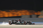 Mercedes driver Lewis Hamilton of Britain steers his car during the second free practice at the Formula One Bahrain International Circuit in Sakhir, Bahrain, Friday, Nov. 27, 2020. (Giuseppe Cacace, Pool via AP)