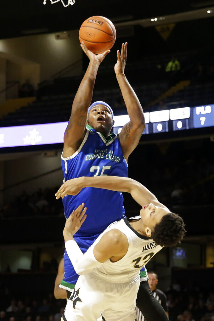 Texas A&M-Corpus Christi forward Tony Lewis (35) shoots over Vanderbilt forward Matthew Moyer (13) in the second half of an NCAA college basketball game Monday, Nov. 11, 2019, in Nashville, Tenn. Vanderbilt won 71-66. (AP Photo/Mark Humphrey)
