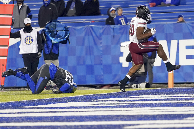 South Carolina running back Kevin Harris (20) scores a touchdown during the second half of an NCAA college football game against Kentucky, Saturday, Dec. 5, 2020, in Lexington, Ky. (AP Photo/Bryan Woolston)