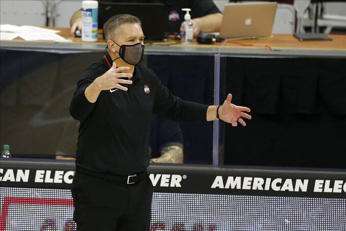 Ohio State head coach Chris Holtmann shouts to his players during the second half of an NCAA college basketball game against Illinois State, Wednesday, Nov. 25, 2020, in Columbus, Ohio. Ohio State beat Illinois State 94-67. (AP Photo/Jay LaPrete)