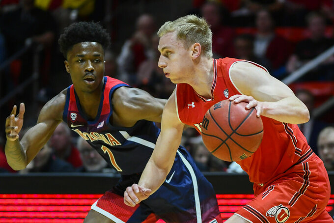 Arizona guard Devonaire Doutrive (1) defends Utah guard Parker Van Dyke, right, during the first half of an NCAA college basketball game Thursday, Feb. 14, 2019, in Salt Lake City. (AP Photo/Alex Goodlett)