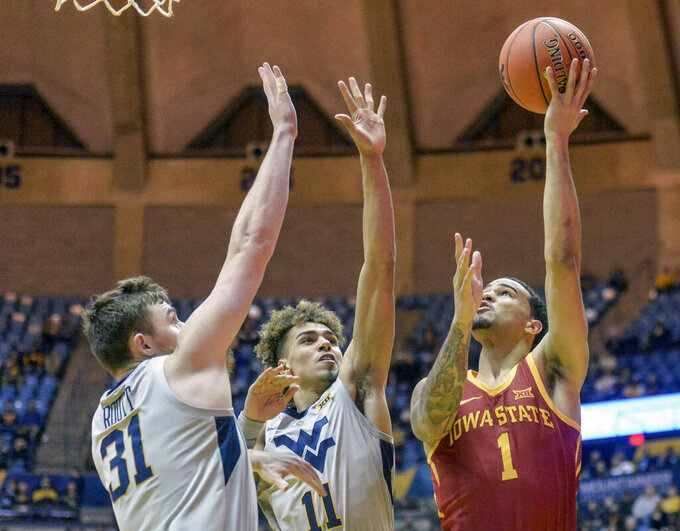Iowa State guard Nick Weiler-Babb (1) shoots over West Virginia  forward Logan Routt (31) during the second half of an NCAA college basketball game Wednesday, March 6, 2019, in Morgantown, W.Va. (William Wotring/The Dominion-Post via AP)