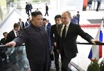 Russian President Vladimir Putin, right, and North Korea's leader Kim Jong Un take an elevator heading to the talks in Vladivostok, Russia, Thursday, April 25, 2019. Putin and Kim are set to have one-on-one meeting at the Far Eastern State University on the Russky Island across a bridge from Vladivostok. The meeting will be followed by broader talks involving officials from both sides. (Alexei Nikolsky, Sputnik, Kremlin Pool Photo via AP)