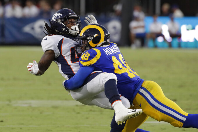 FILE - In this Aug. 24, 2019, file photo, Los Angeles Rams linebacker Travin Howard (48) during an NFL preseason football game against the Denver Broncos in Los Angeles. Howard and rookie Dakota Allen are competing for backup jobs and the final roster spots with the defending NFC champions this week in their preseason finale. (AP Photo/Rick Scuteri,File)