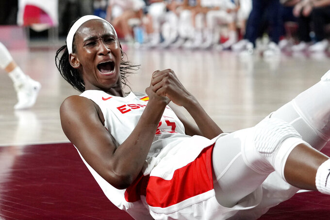 Spain's Astou Ndour (45) celebrates a play during a women's basketball game against Serbia at the 2020 Summer Olympics, Thursday, July 29, 2021, in Saitama, Japan. (AP Photo/Eric Gay)