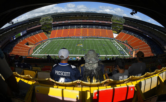 Fans wait for the start of a preseason NFL football game between the Los Angeles Rams and the Dallas Cowboys on Saturday, Aug. 17, 2019, in Honolulu. (AP Photo/Mark J. Terrill)