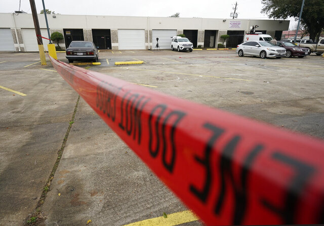 """Police crime scene tape is shown in a parking lot after a deadly shooting Saturday, Dec. 28, 2019, in Houston. Multiple people were wounded when a group filming a music video was """"ambushed"""" on Friday near Houston, Harris County Sheriff Ed Gonzalez said. (Melissa Phillip/Houston Chronicle via AP)"""