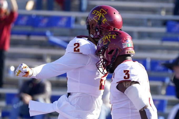 Iowa State running back Kene Nwangwu (3) celebrates his touchdown with teammate Sean Shaw Jr. (2) during the first half of an NCAA college football game against Kansas in Lawrence, Kan., Saturday, Oct. 31, 2020. (AP Photo/Orlin Wagner)