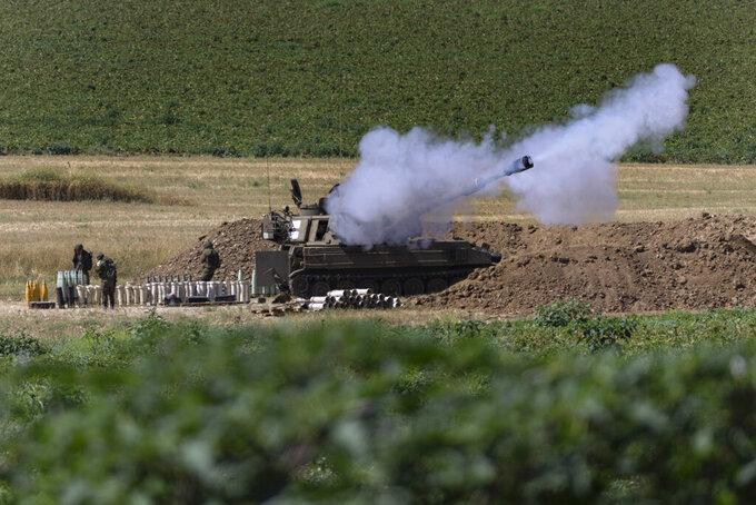 An Israeli artillery unit fires toward targets in Gaza Strip, at the Israeli Gaza border, Tuesday, May 18, 2021. (AP Photo/Tsafrir Abayov)