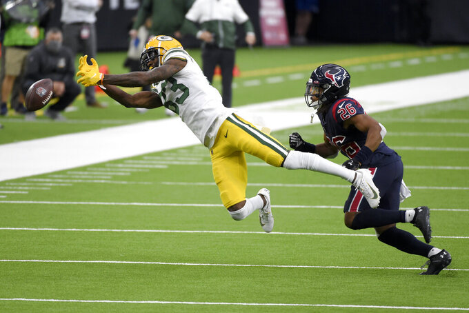 Green Bay Packers wide receiver Marquez Valdes-Scantling, left, is unable to catch a pass as Houston Texans cornerback Vernon Hargreaves III (26) defends during the second half of an NFL football game Sunday, Oct. 25, 2020, in Houston. (AP Photo/Eric Christian Smith)