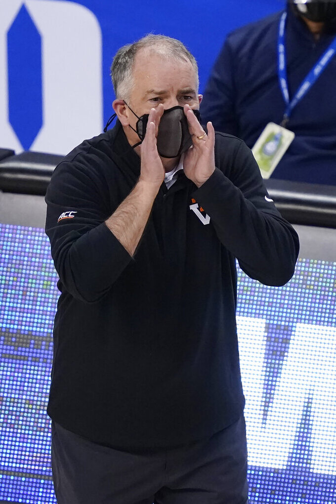 Virginia Tech head coach Mike Young directs his team during the first half of an NCAA college basketball game against North Carolina in the quarterfinal round of the Atlantic Coast Conference tournament in Greensboro, N.C., Thursday, March 11, 2021. (AP Photo/Gerry Broome)