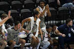Players on the Shawnee State bench celebrate a basket during the second half of the team's NAIA men's basketball tournament final against Lewis-Clark State in Kansas City, Mo., Tuesday, March 23, 2021. (AP Photo/Orlin Wagner)