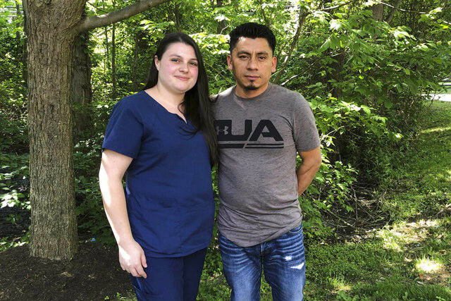 File-In this June 21, 2019, file photo, Alyse Sanchez and her husband, Elmer Sanchez, pose for The Associated Press in Sandy Spring, Md. A federal judge in Maryland has banned immigration officials from arresting, detaining and deporting immigrants who are seeking legal status based on their marriages to U.S. citizens. U.S. District Judge George J. Hazel issued the ruling Friday, Feb. 7, 2020, in a case filed by six couples accusing immigration officials of luring families to marriage interviews in Baltimore, only to detain the immigrant spouse for deportation. Hazel also ordered U.S. Immigration and Customs Enforcement to release from custody immigrants married to U.S. citizens detained before they could complete the first step of the process to obtain legal residency.   (AP Photo/Regina Garcia Cano, File)