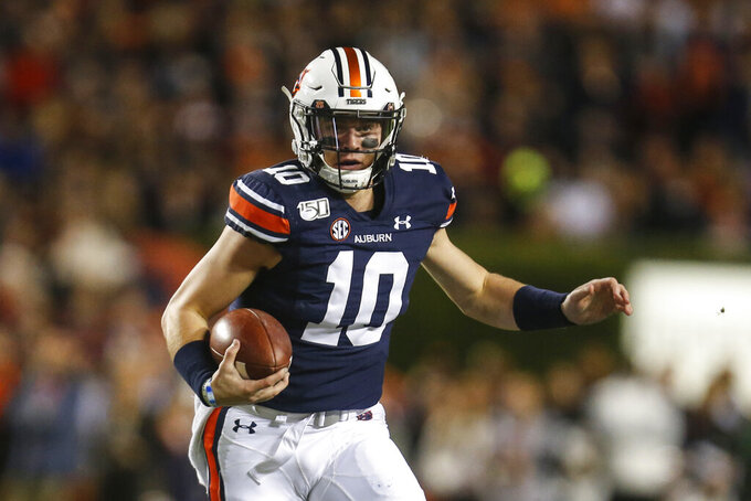 Auburn quarterback Bo Nix (10) carries the ball during the first half of the team's NCAA college football game against Mississippi, Saturday, Nov. 2, 2019, in Auburn, Ala. (AP Photo/Butch Dill)