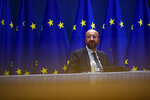 European Council President Charles Michel talks to his team before an online working meeting with German Chancellor Angela Merkel at the European Council headquarters in Brussels, Wednesday, Jan. 20, 2021. (AP Photo/Francisco Seco, Pool)