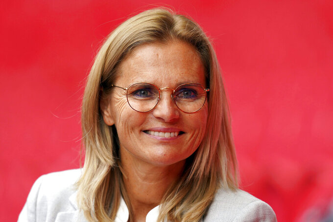 """Sarina Wiegman is unveiled as the new England Women head coach at Wembley Stadium, London, Thursday, Sept. 9, 2021. Setting out on her vision as England manager, Sarina Wiegman was sure of one thing — the Women's World Cup should remain every four years. """"The Euros are great, the World Cup is great, the Olympics are great so that is three tournaments,""""  she said, pitchside at Webmley Stadium on Thursday. (Adam Davy/PA via AP)"""