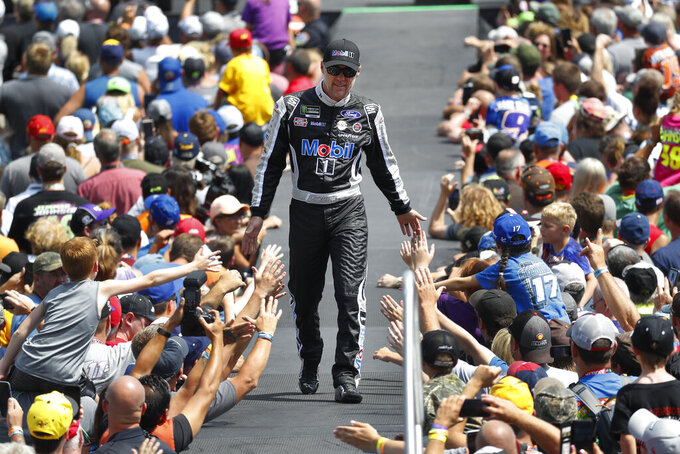 Kevin Harvick greets fans before a NASCAR Cup Series auto race at Michigan International Speedway in Brooklyn, Mich., Sunday, Aug. 11, 2019. (AP Photo/Paul Sancya)