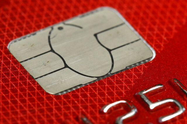 FILE- This June 10, 2015, file photo shows a chip credit card in Philadelphia. Brushing up on the basics of your credit score can give you a fresh start this year and help you know how best to build and defend it. (AP Photo/Matt Rourke, File)
