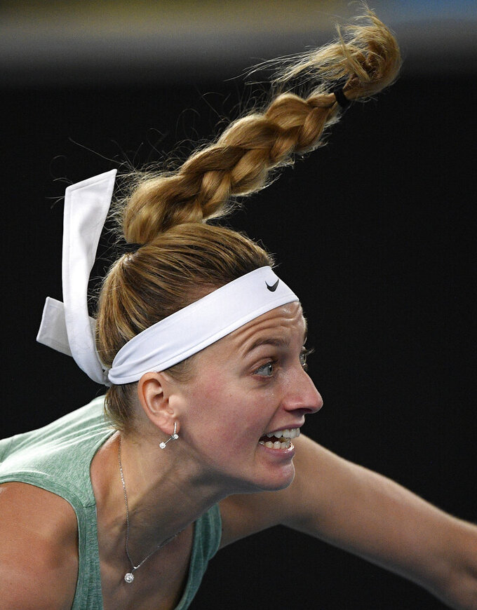 Petra Kvitova of the Czech Republic serves to United States' Venus Williams during a tuneup tournament ahead of the Australian Open tennis championships in Melbourne, Australia, Tuesday, Feb. 2, 2021. (AP Photo/Andrew Brownbill)