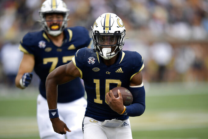 Georgia Tech quarterback Jeff Sims (10) runs out of the pocket against Pittsburgh during the first half of an NCAA college football game, Saturday, Oct. 2, 2021, in Atlanta. (AP Photo/Mike Stewart)