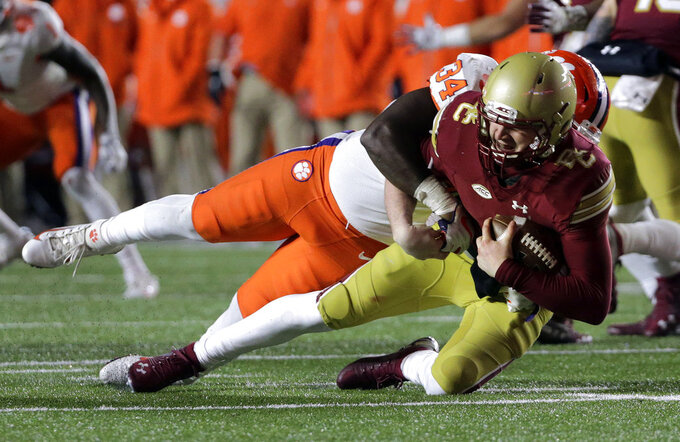 Clemson linebacker Kendall Joseph, rear, sacks Boston College quarterback EJ Perry during the second half of an NCAA college football game Saturday, Nov. 10, 2018, in Boston. (AP Photo/Elise Amendola)