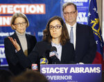 ​Lauren Groh-Wargo, Stacey Abrams' campaign manager, stands with attorneys at a news conference Thursday, Nov. 8, 2018, in Atlanta. Republican Brian Kemp resigned Thursday as Georgia's secretary of state, a day after his campaign said he's captured enough votes to become governor despite his rival's refusal to concede. Abrams' campaign immediately responded by refusing to accept Kemp's declaration of victory in the race and demanding that state officials