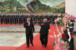FILE - In this Jan. 8, 2019, file photo released by China's Xinhua News Agency, North Korean leader Kim Jong Un, right, is cheered by children during a welcome ceremony held by Chinese President Xi Jinping, left, at the Great Hall of the People in Beijing. Xi said North Korea is taking the