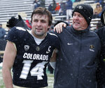Colorado head coach Mike MacIntyre, right, congratulates his son, wide receiver Jay MacIntyre, during a senior day ceremony before the first half of an NCAA college football game against Utah, Saturday, Nov. 17, 2018, in Boulder, Colo. (AP Photo/David Zalubowski)