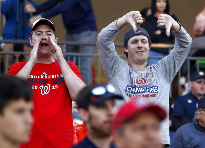 Washington Nationals fans boo as Houston Astros players walk onto the field for a spring training baseball game in West Palm Beach, Fla., Saturday, Feb. 22, 2020. (Karen Warren/Houston Chronicle via AP)