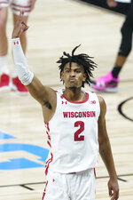 Wisconsin's Aleem Ford reacts after hitting a shot as time expired to end the first half of an NCAA college basketball game against Penn State at the Big Ten Conference tournament, Thursday, March 11, 2021, in Indianapolis. (AP Photo/Darron Cummings)