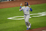 Kansas City Royals' Carlos Santana gestures after hitting a solo home run off Baltimore Orioles starting pitcher Alexander Wells during the fourth inning of a baseball game, Tuesday, Sept. 7, 2021, in Baltimore. (AP Photo/Julio Cortez)