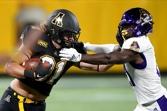 Appalachian State tight end Miller Gibbs pushes off rom East Carolina safety Warren Saba during the first half of an NCAA college football game Thursday, Sept. 2, 2021, in Charlotte, N.C. (AP Photo/Chris Carlson)