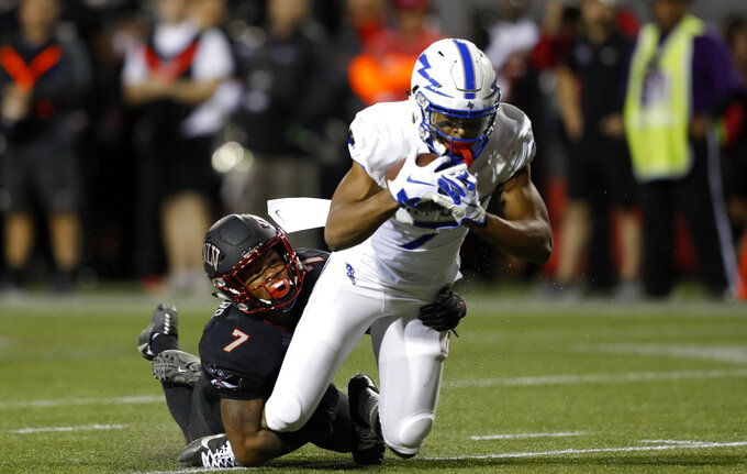 UNLV defensive back Jericho Flowers (7) takes down Air Force wide receiver Geraud Sanders (7) after a reception during the first half of an NCAA college football game in Las Vegas, Friday, Oct. 19, 2018. (Steve Marcus/Las Vegas Sun via AP)