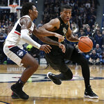 Central Florida's Aubrey Dawkins dribbles as Connecticut's Christian Vital, left, defends during the first half of an NCAA college basketball game, Saturday, Jan. 5, 2019, in Hartford, Conn. (AP Photo/Jessica Hill)