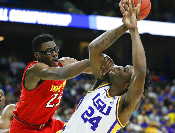 Maryland's Jalen Smith, left, fouls LSU's Emmitt Williams (24) as he goes up for a shot during the first half of a second-round game in the NCAA men's college basketball tournament in Jacksonville, Fla., Saturday, March 23, 2019. (AP Photo/Stephen B. Morton)