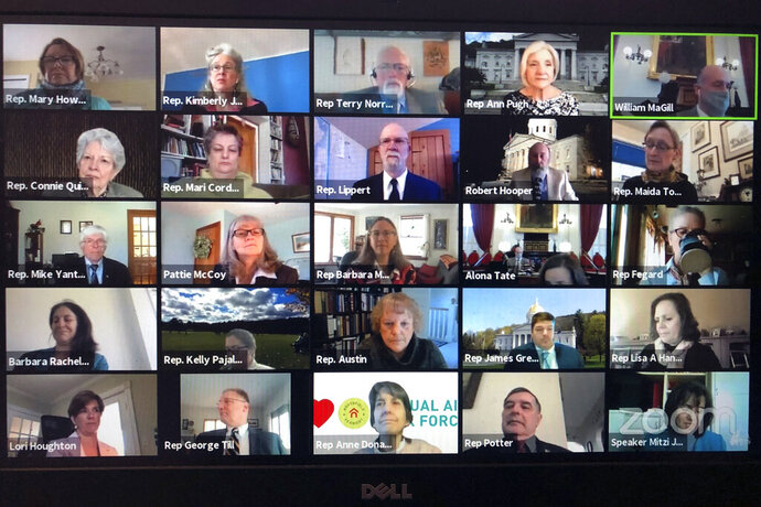 FILE - In this April 23, 2020 file photo, members of the Vermont House of Representatives convene in a Zoom video conference for its first full parliamentary online session in Montpelier, Vt. Zoom Video Communications is rapidly emerging as the latest internet gold mine as millions of people flock to its conferencing service to see colleagues, friends and family while tethered to their homes during the pandemic. The release Tuesday, June 2, 2020 of the once-obscure company's financial results for the February-April period provided a window into the astronomical growth that has turned it into a Wall Street star.  (Wilson Ring/Zoom via AP, File)