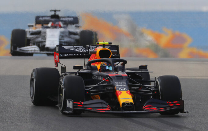 Red Bull driver Alexander Albon of Thailand steers his car during a practice session at the Istanbul Park circuit racetrack in Istanbul, Friday, Nov. 13, 2020. The Formula One Turkish Grand Prix will take place on Sunday. (AP Photo/Kenan Asyali, Pool)